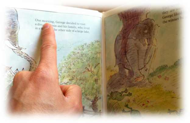 We can help our kids learn to read by pointing at the words as we read children's stories with them
